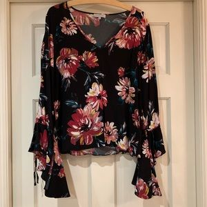 1. State Black and burgundy floral blouse.